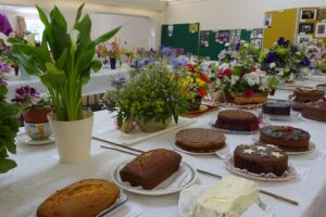Photo of cakes and flower arrangements