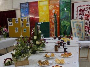 Photograph of macaroons, jams, floral art and photography entries